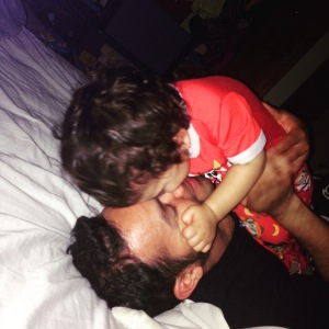 Michael giving Jack kisses to  and snuggles before bed.
